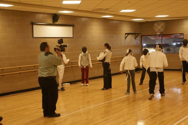 Jamie Zepp shooting footage at fencing practice